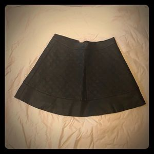 Quilted black leather look circle skirt